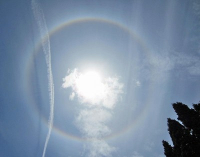 Actually taken in June-2013; lots of chemtrail action overhead.  An eerie combination of a chemtrail and a sundog that came into formation after the jet flew off.